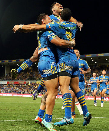 SHOT BRO: Ken Sio of the Eels celebrates with teammates Will Hopoate and Chris Sandow after scoring a try.
