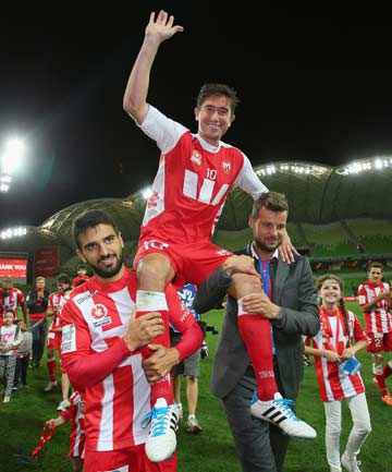 CAREER OVER: Harry Kewell is carried off the pitch by Melbourne Heart team-mates after the final match of his 19-year professional career.