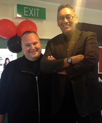 DRAWING CLOSER: Kim Dotcom and Hone Harawira, standing on a chair, at the Mana