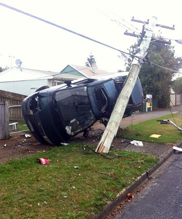 van crashes in power pole