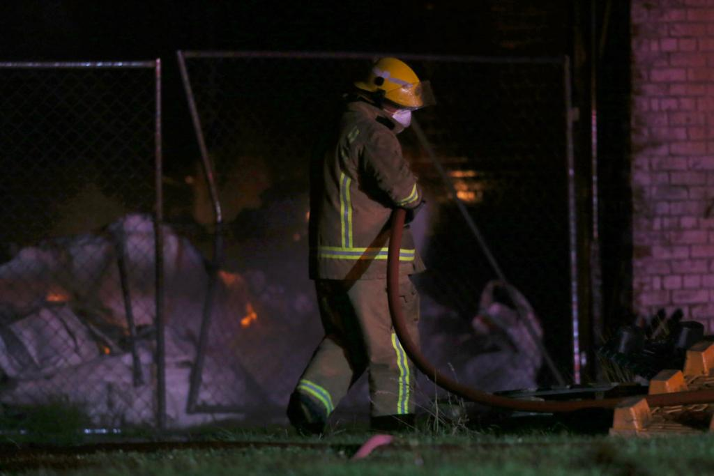 Firefighters at the scene of a large industrial stock fire in Gore.