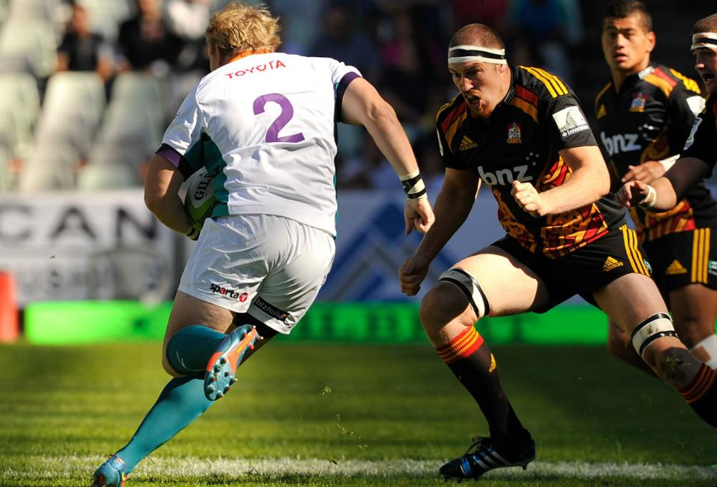 Chiefs lock Brodie Retallick lines up Cheetahs hooker Adriaan Strauss for a hard tackle.