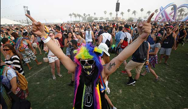 COACHELLA MAGIC:  A concertgoer dances during the performance by Kid Cudi