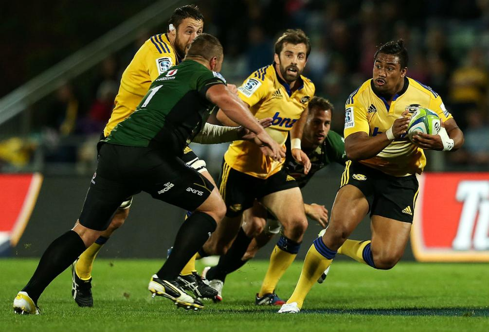 Julian Savea makes a break for the Hurricanes against the Bulls in Napier.