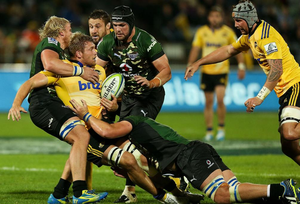 Hurricane Brad Shields is wrapped up by a swarming Bulls defence at McLean Bark.
