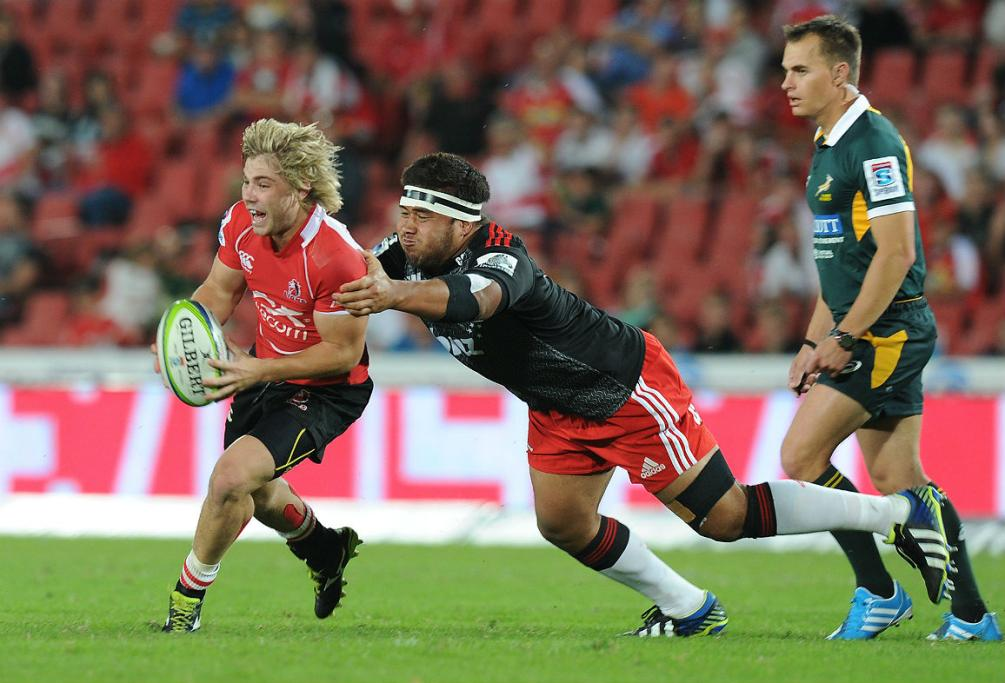 Nepo Laulala of Crusaders tackling Faf de Klerk of Lions during the teams' clash at Ellis Park.
