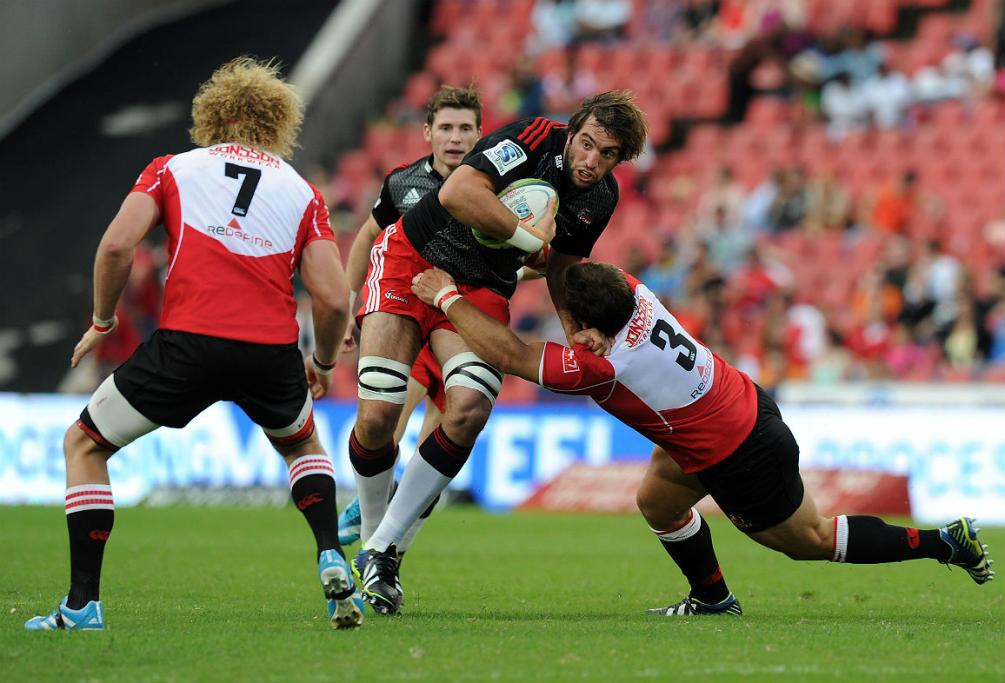 Crusaders lock Sam Whitelock takes a charge at the Lions defence.
