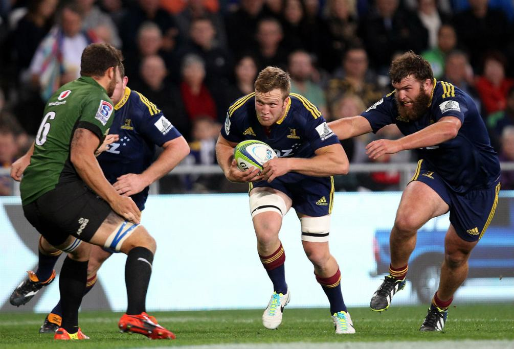 Gareth Evan, with the support of Liam Coltman, makes a charge for the Highlanders against the Bulls.