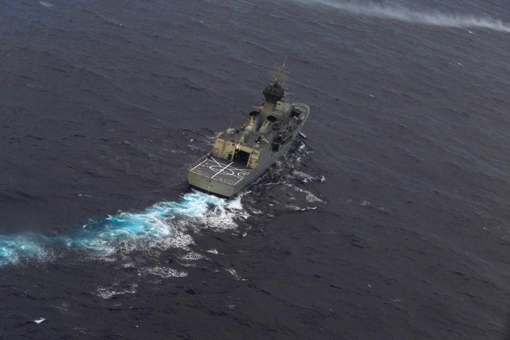 Thirty-eight days after the plane went missing, an Australian navy ship is guided into position by a Royal New Zealand Airforce P-3K2 Orion aircraft. Officials say they will deploy an underwater robot to aid in the hunt.