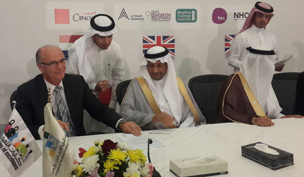 EXPORT EDUCATION: Wintec chief executive Mark Flowers, left, recently signed the contracts for the colleges in Saudi Arabia.