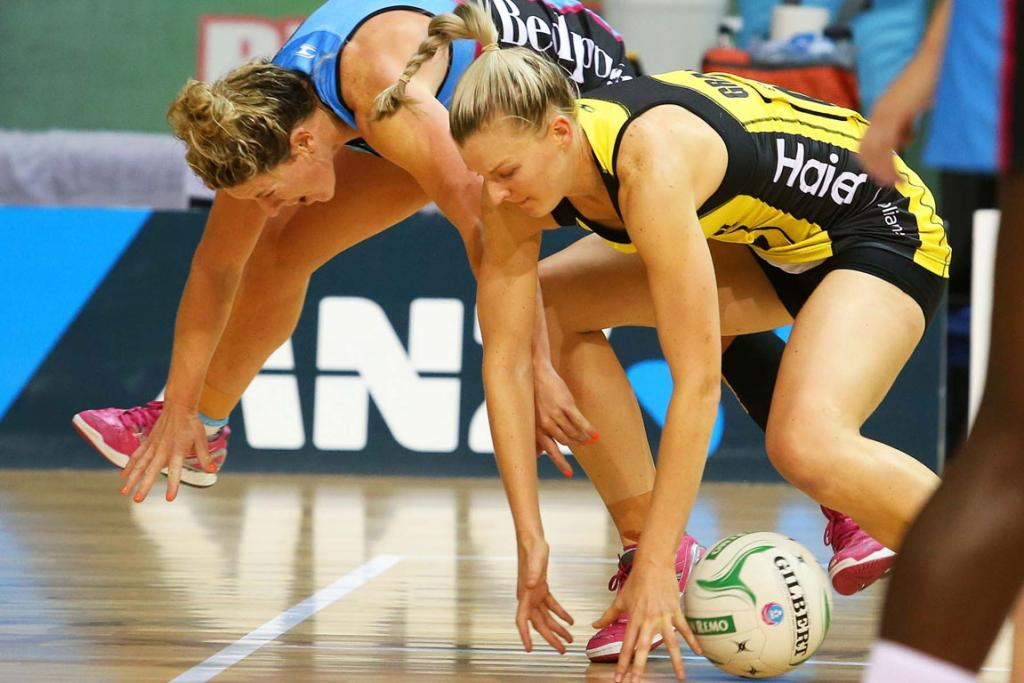 Steel player Phillipa Finch, left, and Pulse player Katrina Grant fight for possession of the ball.