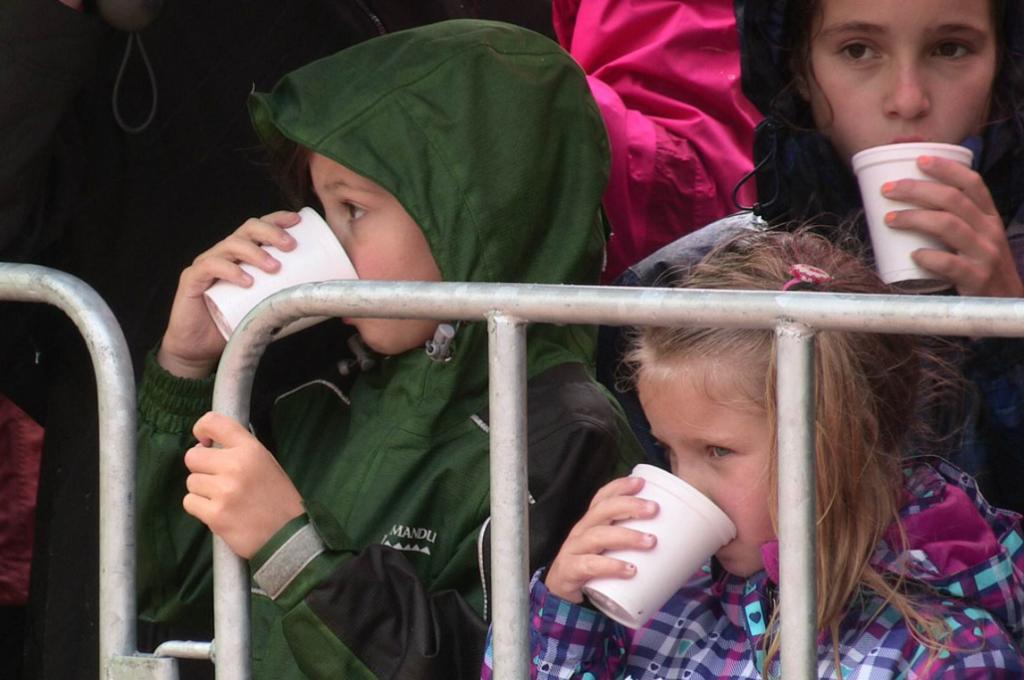 Warm drinks were the order of the day as royals fans weathered the wet wait.