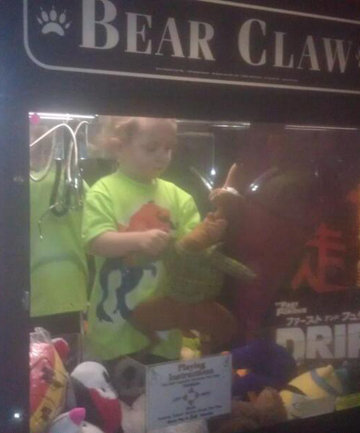 HAPPY CAMPER: Kael Ireland, 3, plays in the Bear Claw.