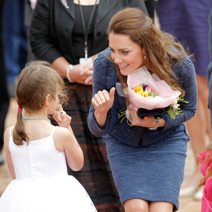 Always gracious, Kate thanked a girl for her gift while on walkabout in Wellington's Civic Square.