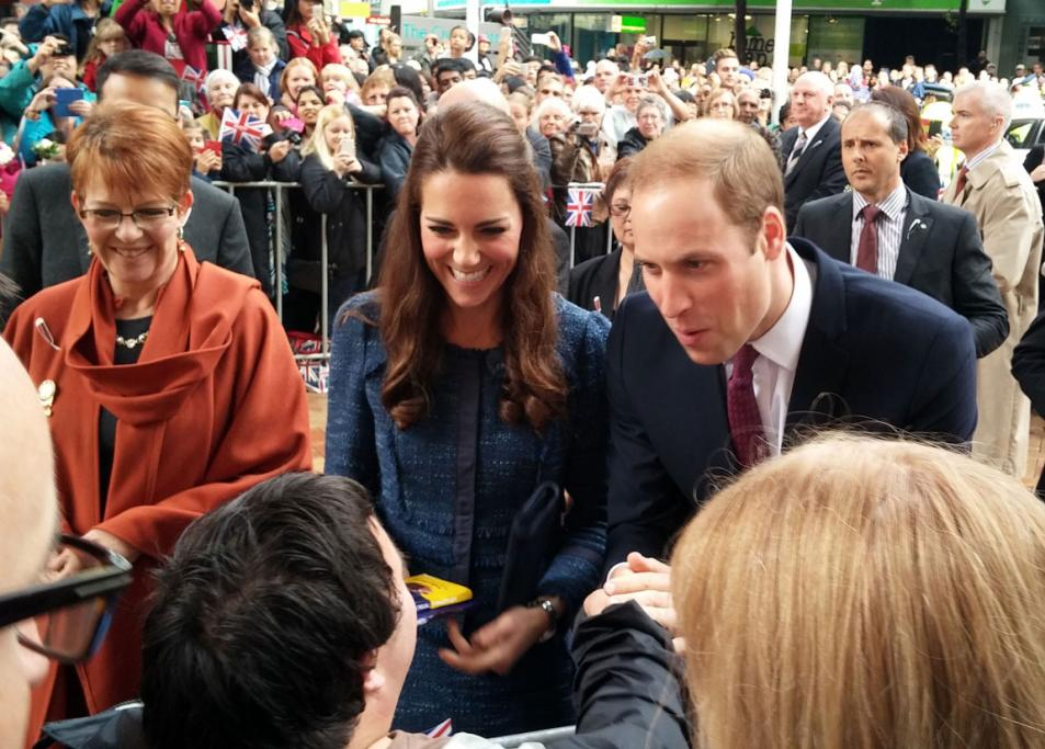 In Wellington's Civic Square, Wills and Kate appeared excited by the gift of chocolate a royals fan gave them.