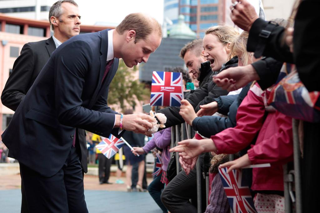 Wills accepts a gift from this excited royals fan in Wellington's Civic Square.