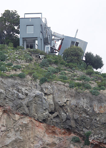 TEETERING: A house on Richmond Hill above Sumner has split in two and is teetering on the edge of the cliff.