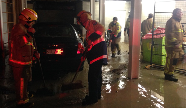 Firefighters clean up after Oriental Bay bank collapse