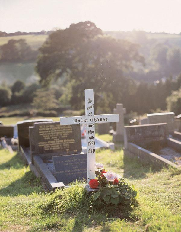 Dylan Thomas' grave at St. Martin's Church in Laugharne, Wales.