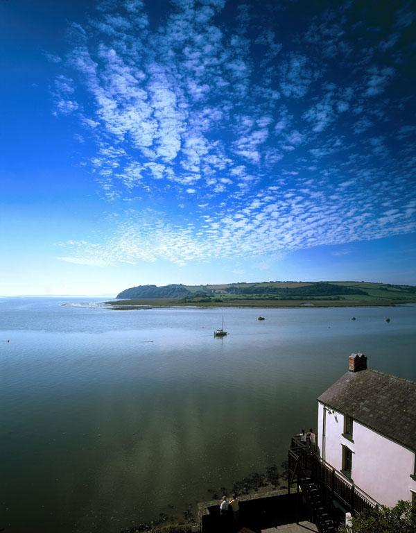 The boathouse and Taf Estuary, Laugharne, Wales.