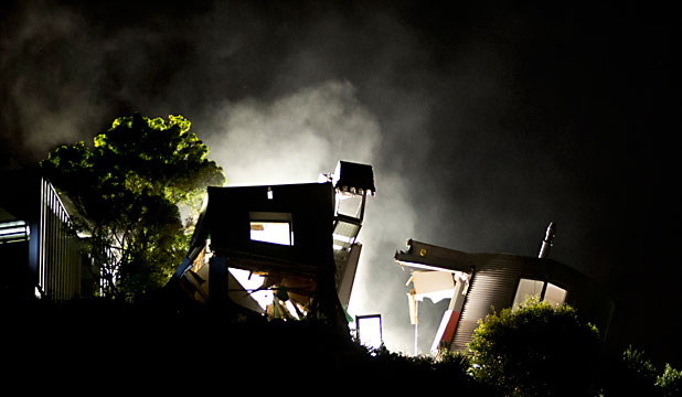 DEMOLITION: A house on Richmond Hill above Sumner has split in two and is teetering on the edge of the cliff.