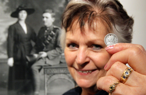 LUCKY CHARM: Anne Conroy with her lucky sixpence, which belonged to her grandfather Alfred Hart.