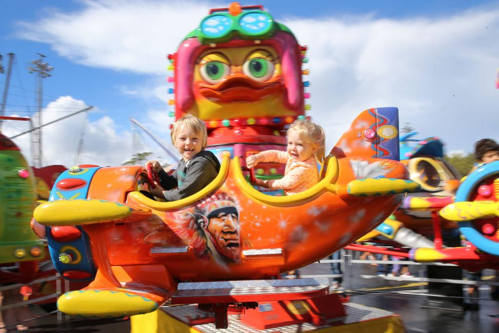 Cole  and Mila Cunningham take a ride at the Royal Easter Show in Auckland.