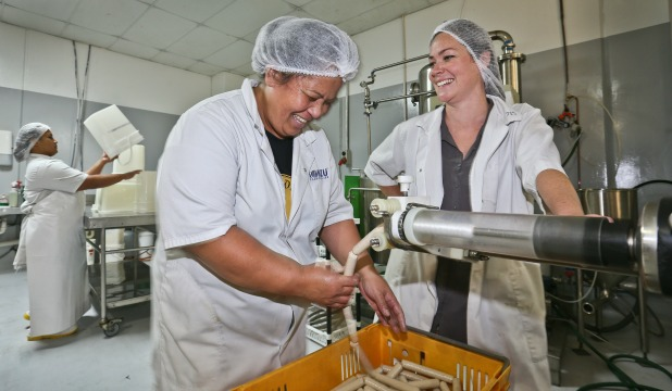 General manager  Jesse Chalmers, right, at the Chalmers Organics factory with worker Siusiu Pusi