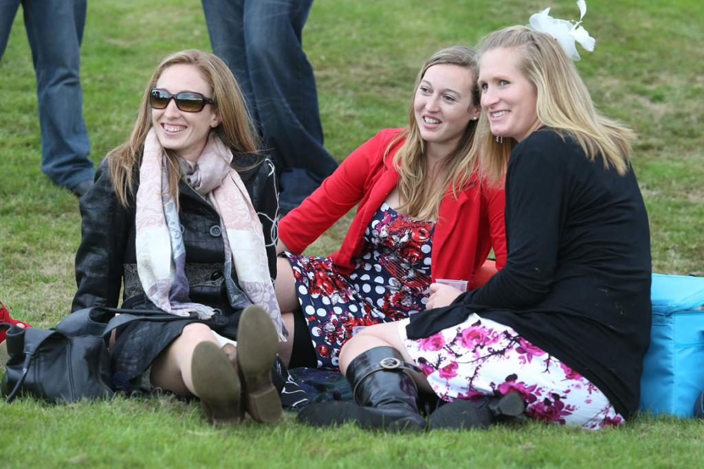Pictured enjoying the atmosphere are, from left, Morghan Dawson, of Colac Bay, Jemma Robertson, of Invercargill, and Megan Colling, of Fairfax, at the Riverton Racing Club's Easter Carnival.