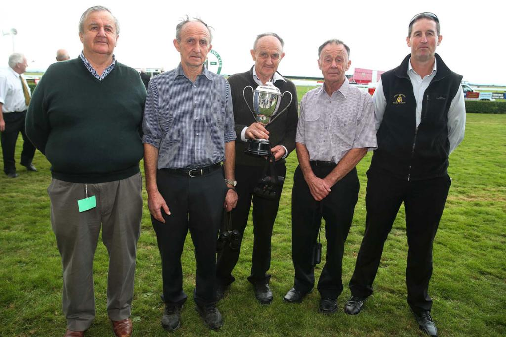 The Dennis brothers, from left, Martin, Tony, Ray, Joe together with trainer Steve Anderton. The brothers own Solitaire.