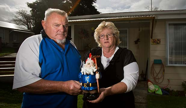 GNOMES GONE: Laurie and Brenda Kirkwood from Feilding with their two remaining gnomes after their collection was stolen from their garden on Thursday night or Friday morning.