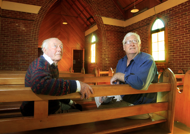 Coming down: St Peter Chanel Church in Ward will be demolished due to quake damage. The church committee is seeking expressions of interest from the public to buy the doors, windows, roof materials and church bell. Pictured are parishioners Tom Hickman, left, and Kevin Loe, right