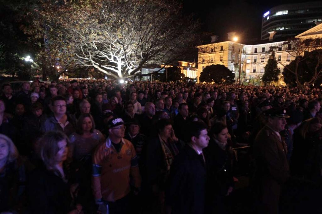 The crowd gathers in the darkness at Parliament for the dawn Anzac service.