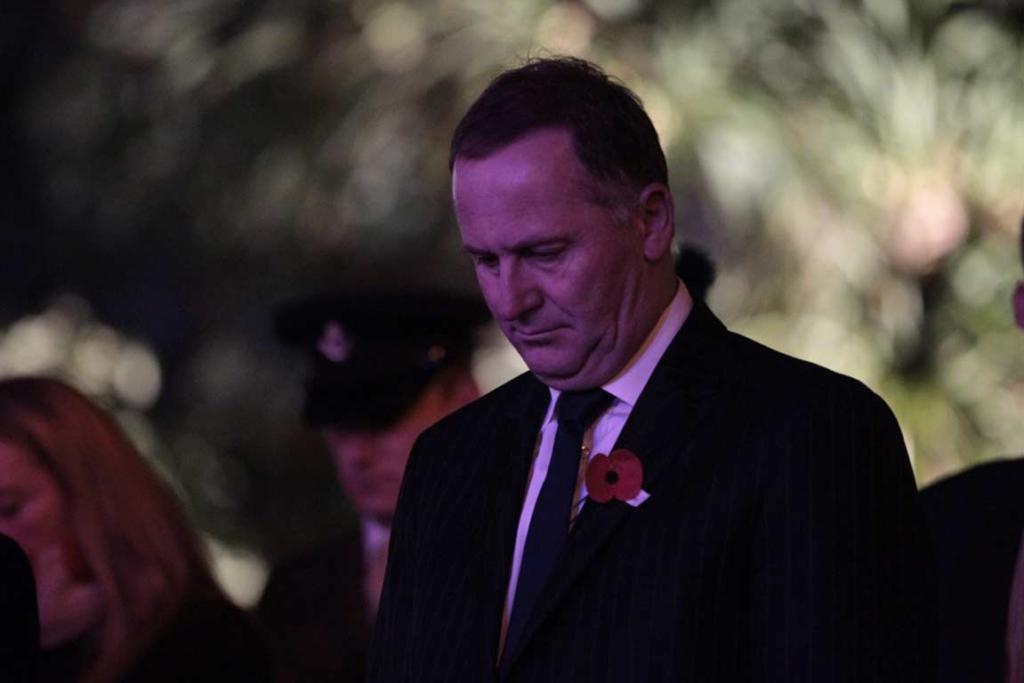 New Zealand prime minister John Key bows his head in honour of fallen soldiers.