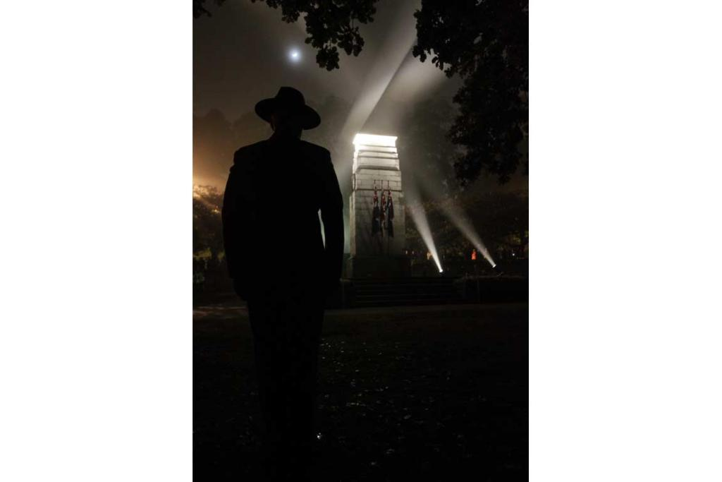 A soldier stands at attention near the Hamilton war memorial.