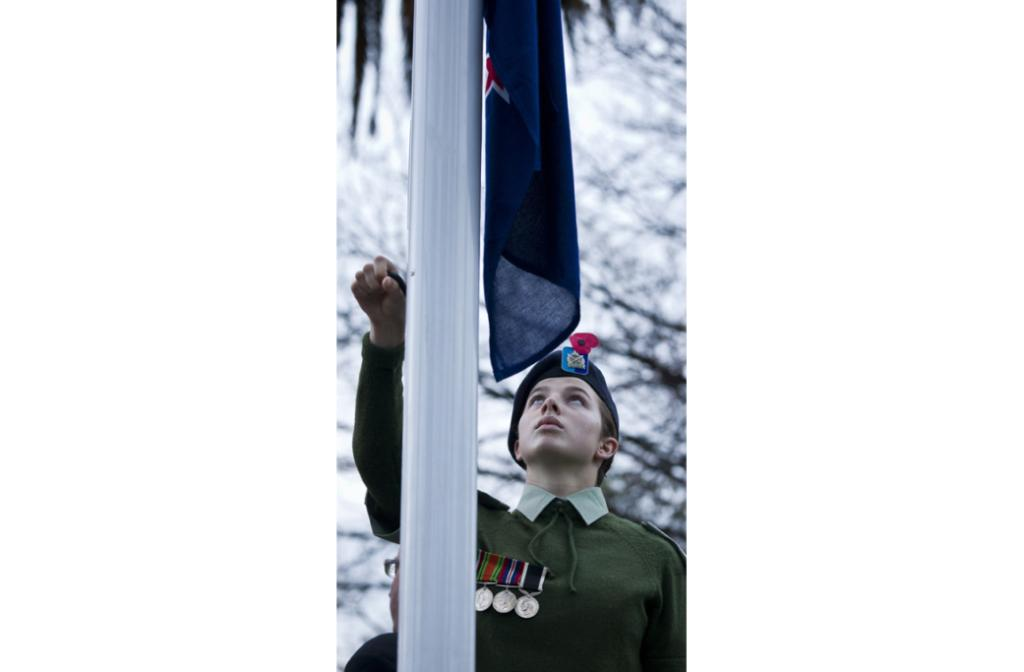 Cadet Emma-Lea Hughson lowers the New Zealand flag during the dawn service at Anzac Park this morning.