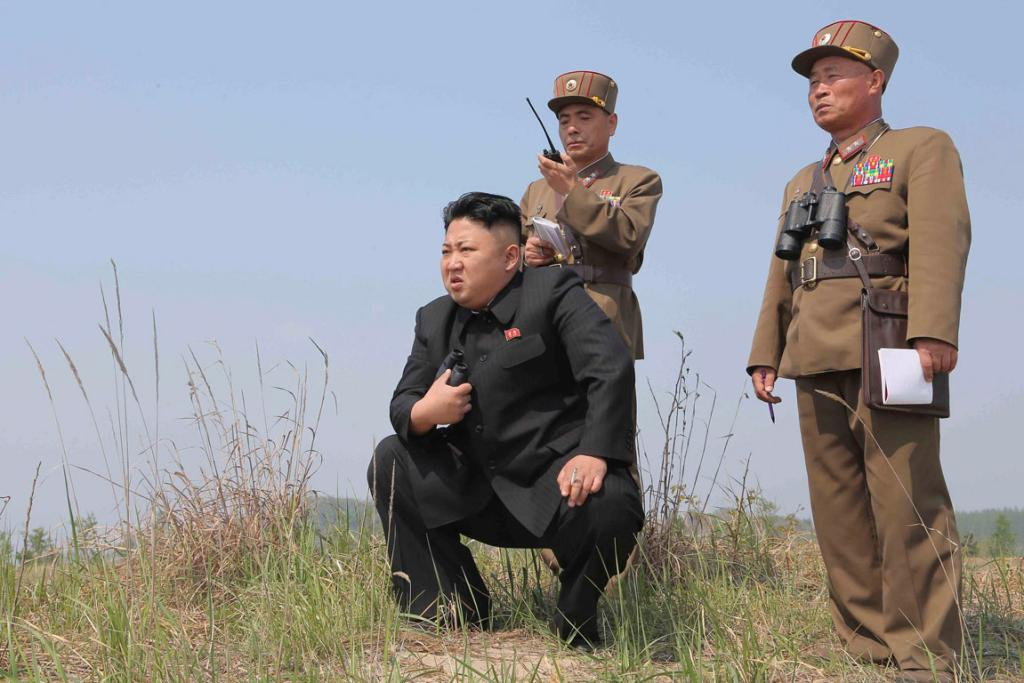 """""""Boys, you just try to look official while I strike a pose here. Oh yeah, it's good to be Kim."""""""