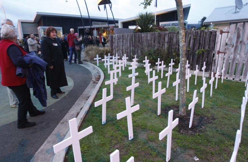 Never forgotten - a crowd gathered this morning at the Takaka Memorial Library to honour those who had fallen.  To the right, 72 crosses honour those who gave their lives in war to protect New Zealand over the past 100 years.