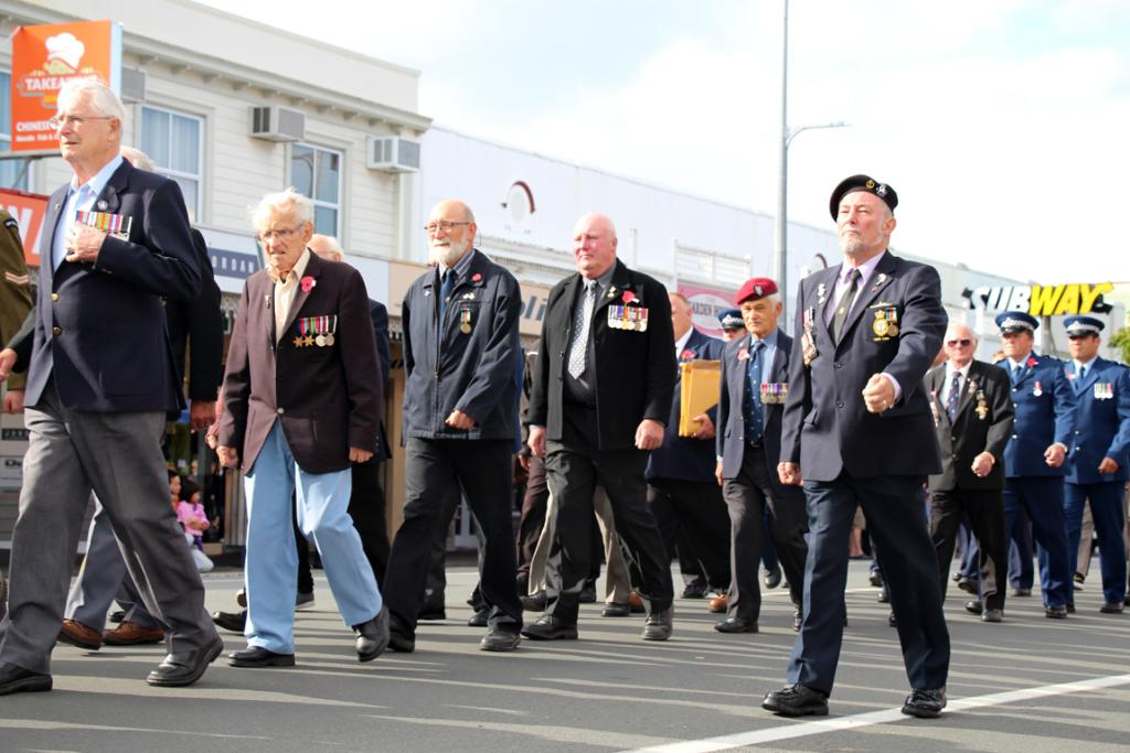 Returned servicemen and their families march down Pollen St for the Thames Anzac Day parade.