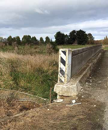 CRASH SCENE: The men died after their Toyota Hilux ute left the Riversdale-Waikaia road and hit the edge of a concrete bridge,  police said.