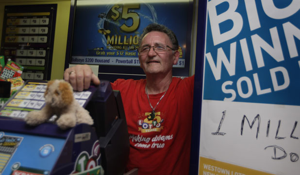 WINNING STREAK: Westown Lotto owner Morrie Collins was quick to put up signs advertising he'd sold the top prize in Lotto's Christmas promotion.