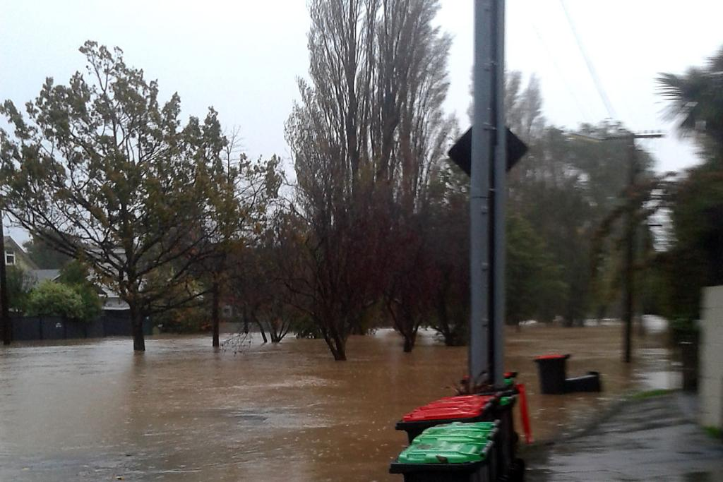 RIVER OVERFLOWS: Palatine Tce disappears under the Heathcote.