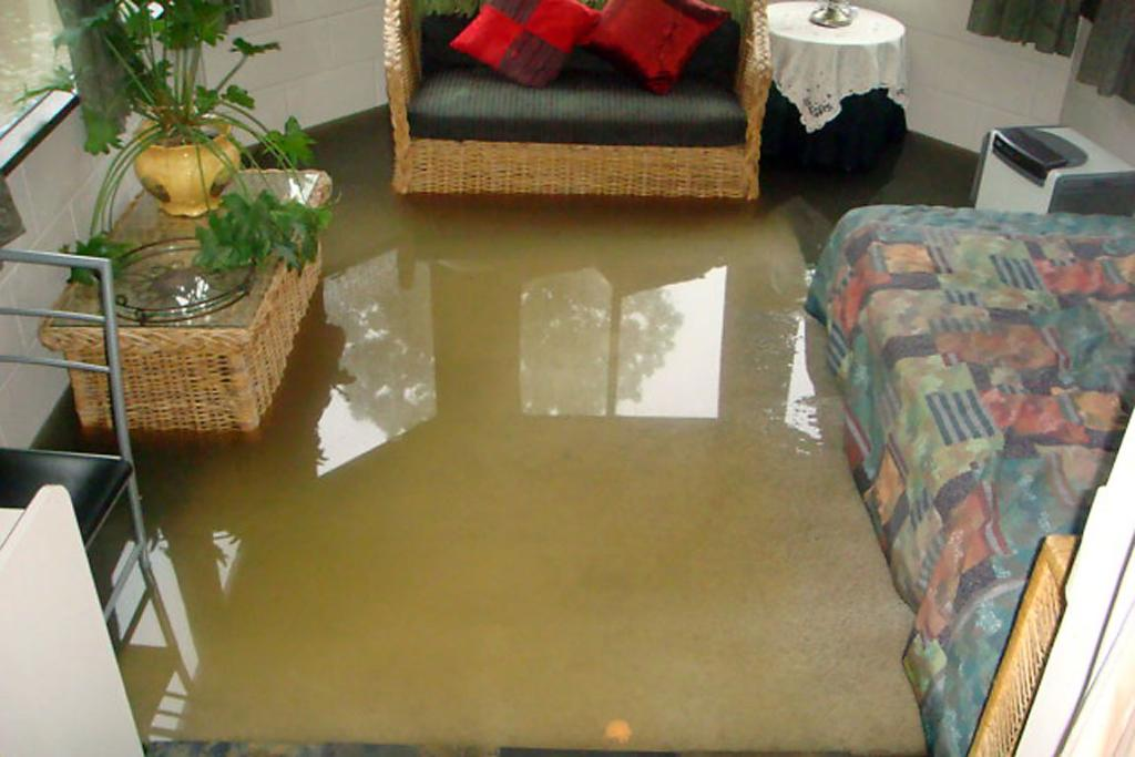 INDOOR POOL: A Waimea Tce home has inches of water inside.