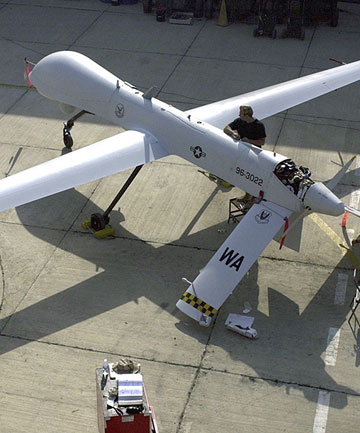 KILLING MACHINE: Members of the US Air Force 11th Reconnaissance Squadron perform pre-flight checks on a Predator drone.