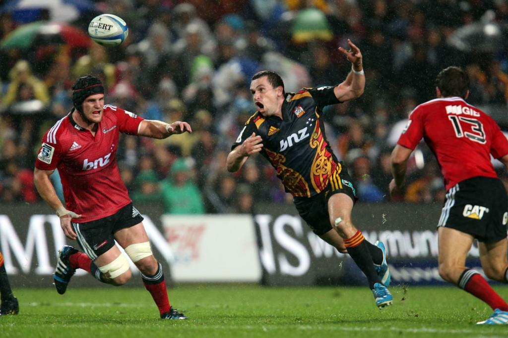Tom Marshall of the Chiefs loses possession in the slippery conditions during the Chiefs and Crusaders match.