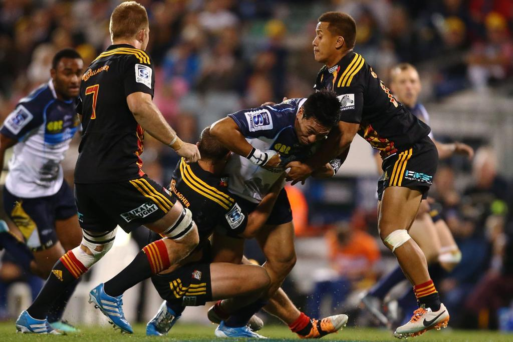 Christian Lealiifano of the Brumbies is tackled during their match against the Chiefs.