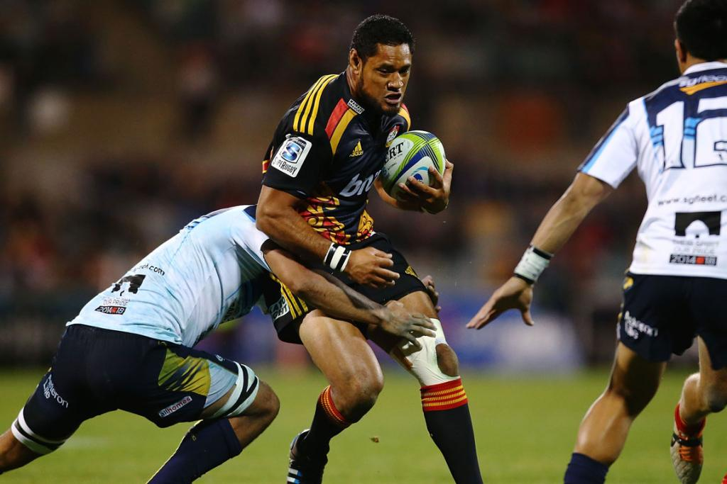 Tevita Koloamatangi of the Chiefs is tackled during their match against the Brumbies.