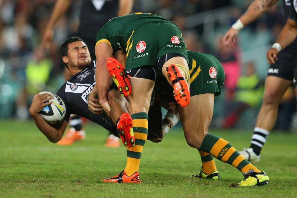Kiwis fullback Peta Hika is driven back in a tackle.