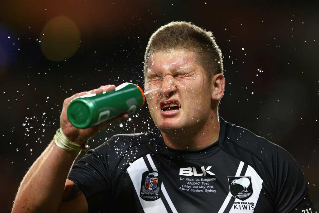 Kiwis prop Greg Eastwood cools himself down with a spray of water.