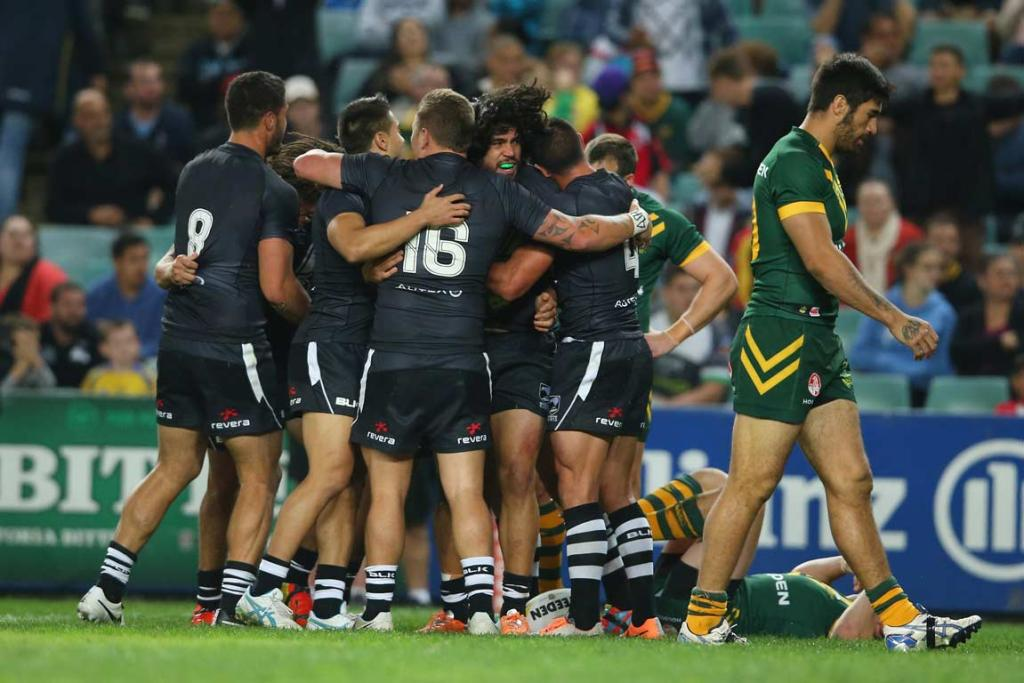 Kiwis stand-off Tohu Harris is congratulated after his first half try.